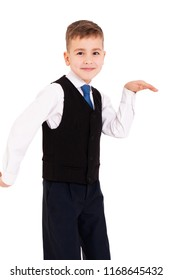 Schoolboy in white shirt and black waistcoat on isolated white background holding hands up like dancing an Egyptian dance.