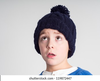 Schoolboy with a wool  bobble hat
