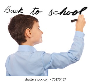 "Schoolboy writing ""back to school"" on an imaginary board"