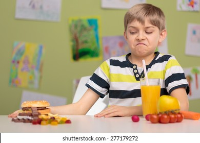 Schoolchild choosing healthy food for school lunch