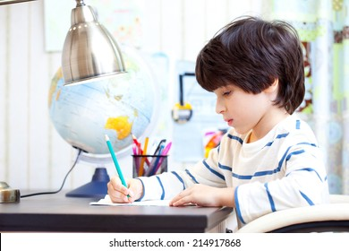 schoolchild doing homework at his desk