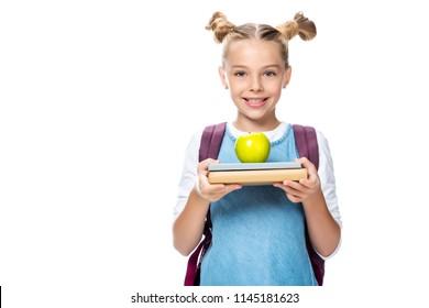 schoolchild holding apple on books isolated on white