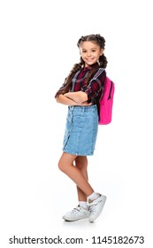 schoolchild with pink backpack standing with crossed arms isolated on white