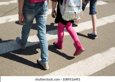 Schoolchildren crossing the road on their way to school
