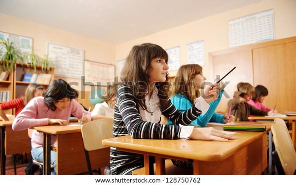 Schoolchildren during lesson in classroom.
