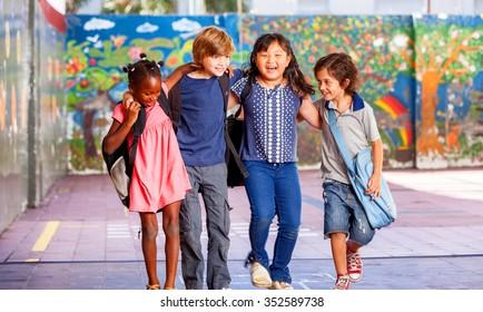 Schoolchildren embracing happy. Multi cultural racial classroom.