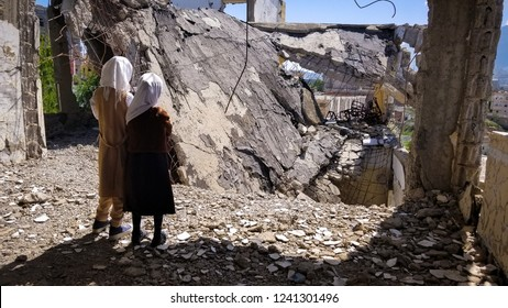 Schoolchildren stand on their destroyed school because of the war in the Yemeni city of Taiz Yemen / Taiz City. 2018-11-02