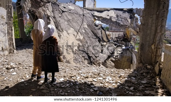 Schoolchildren stand on their destroyed school because of the war in the Yemeni city of Taiz Yemen / Taiz City. 2018-11-02