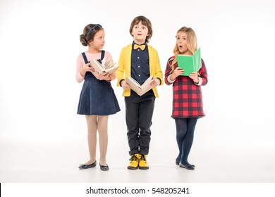 Schoolchildren standing with books isolated on white