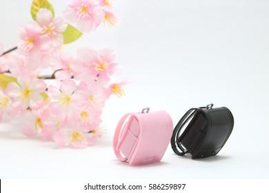 Schoolchild's rucksacks and cherry blossoms on white background. randoseru School ceremony  concept.
