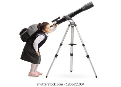 Schoolgirl with a backpack looking through a telescope isolated on white background