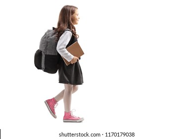 Schoolgirl with a backpack walking isolated on white background