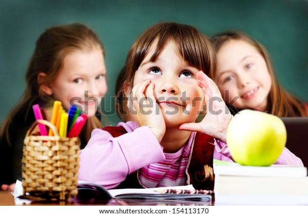 Schoolgirl in the clasroom - back to school
