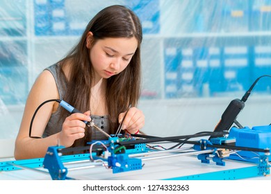Schoolgirl in the classroom design and development of robots