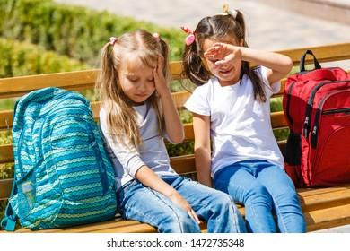 Schoolgirl concept. Schoolgirl do not want to go to school. Cute schoolgirl keep arms crossed. Little schoolgirl stand on desk.