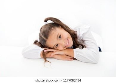 Schoolgirl cute ponytail hairstyle. Excellent pupil lean on desk isolated white. Perfect schoolgirl with tidy fancy hair. School hairstyle ultimate top list. Prepare your kid for first school day.