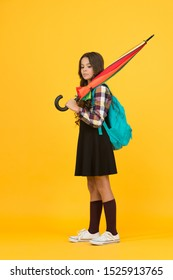 Schoolgirl daily life. Girl with umbrella. Happy childhood. Kid happy schoolgirl with umbrella. Fall weather forecast. Feeling carefree. Rainy september. Adorable small schoolgirl with backpack.