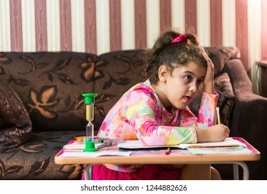 Schoolgirl doesn`t know how to solve all the homework is at  perplexity