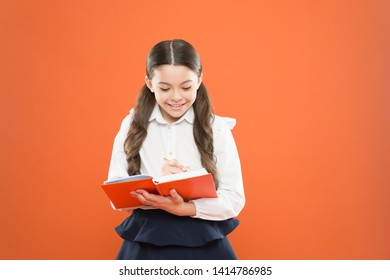 Schoolgirl enjoy study. Kid school uniform hold workbook. School lesson. Child doing homework. Your career path begins here. Write essay or notes. Inspiration for study. Back to school. Knowledge day.