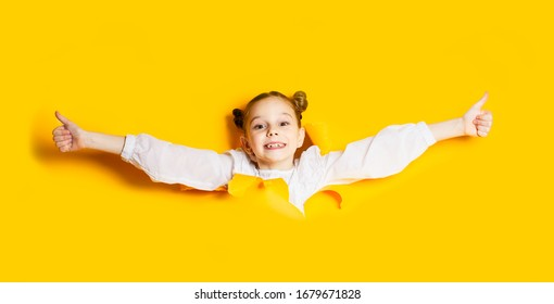 Schoolgirl free herself out of yellow paper