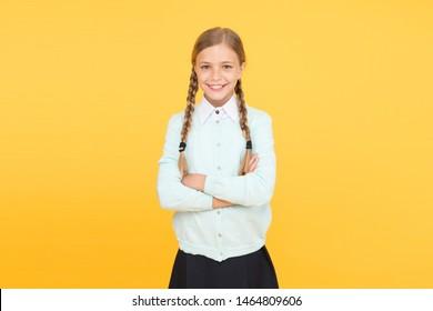 Schoolgirl happy smiling pupil long hair. Beginning of academic year. Educational activity. Homeschooling or visiting regular school. Efficiency of studying. Adorable schoolgirl. Diligent schoolgirl.