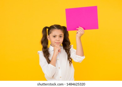 Schoolgirl hold poster copy space. News information promotion. Back to school concept. Upcoming event. Look here. Girl school uniform hold poster. Changes coming. Schoolgirl pupil show poster.