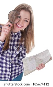 schoolgirl holding a magnifying glass and map