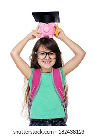 schoolgirl holding piggy bank with mortar board:savings for future education