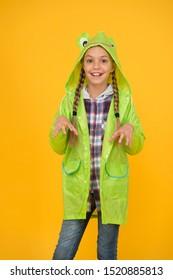 Schoolgirl hooded raincoat enjoy rainy weather. Rainproof accessory. Waterproof clothes every kid should try. Kid girl happy wear raincoat. Waterproof cloak. Waterproof fabric for your comfort.