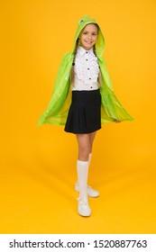 Schoolgirl hooded raincoat going to school. Waterproof clothes. Kid girl happy wear raincoat. Rain is not hindrance. Waterproof cloak. Waterproof fabric for your comfort. Rainproof accessory.