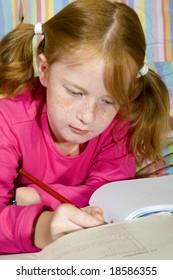 Schoolgirl is making homework