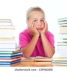 schoolgirl on desk frustrated of the many books
