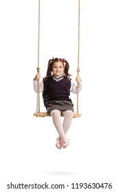 Schoolgirl on a swing isolated on white background