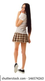 Schoolgirl in plaid skirt isolated