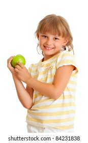 Schoolgirl portrait holding green apple isolated