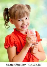 Schoolgirl portrait with water glass outdoor