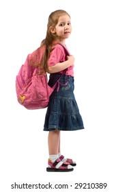 schoolgirl with school backpack on her shoulders