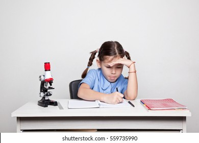 The schoolgirl sitting at the desk