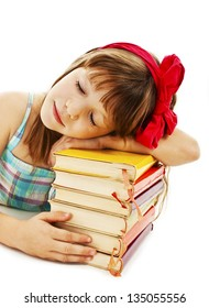 Schoolgirl sleeping on school books. Isolated on white background
