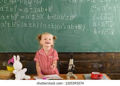 Schoolgirl smile on classroom chalkboard. Happy schoolgirl have lesson in primary school.