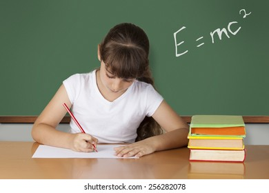Schoolgirl studying at the classroom