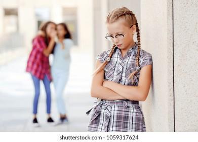 Schoolgirl suffering from bullying in the school