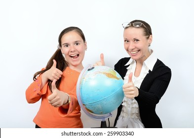 Schoolgirl teenager and a woman teacher with globe happy successful learning