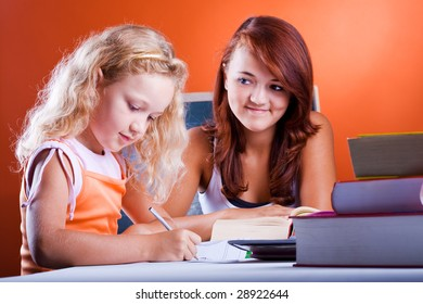 schoolgirls with the books making homework