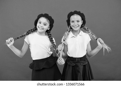Schoolgirls french little kids smiling face posing hat red background. How to wear french beret. Beret style inspiration. How to wear beret like fashion girl. Fashionable beret accessory for female.