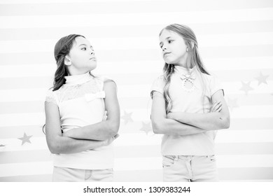 Schoolgirls haughty arrogant with folded arms chest. Best friends become enemies. Friendship relations issues. Girlish friendship problem. She definitely jealous. Girl arrogant faces confident pose.