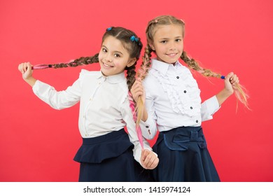 Schoolgirls tidy appearance glad to meet you. Meet new friends in school. School friendship. Should school be more fun. Schoolgirls with cute hairstyle and happy smiles. Best friends excellent pupils.