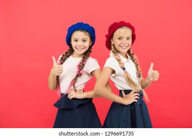 Schoolgirls wear formal uniform and beret hats. Elite school college. Education abroad. Apply form enter international school. Sisters friends girls. French language school. School fashion concept.