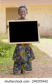 Schooling Symbol: Gorgeous Young Malian Child Holding Blackboard Copy Space