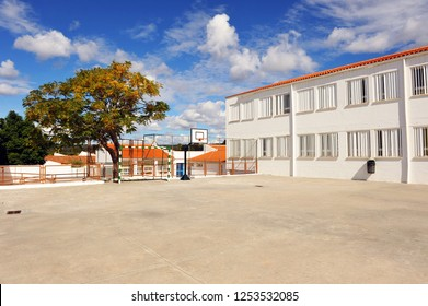 Schoolyard of a public school with basketball court